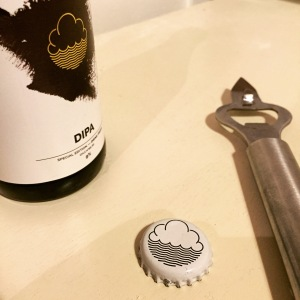 Distinctive Cloudwater logo on the cap and label
